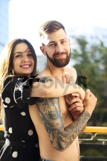 Young tattooed stylish couple in love