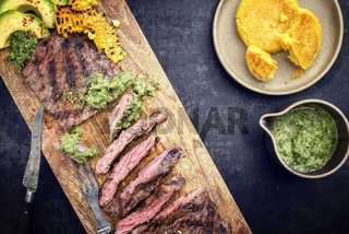 Barbecue dry aged wagyu flank steak with arepas corn
