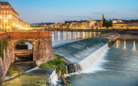 Evening mood on the weir Pescaia di Santa Rosa Arno in Florence Tuscany Italy