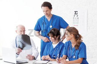 Medical team checking X-ray results