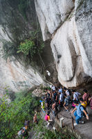 Tourists on steep mountain trail in Huashan mountain