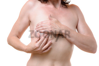 Middle-aged woman checking her breast for lumps