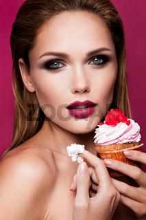 Beautiful fashion girl with cupcake