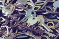 Many of the vintage metal keys to a door and furniture
