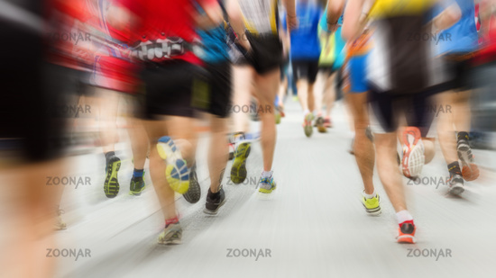 Runners legs at the marathon from behind