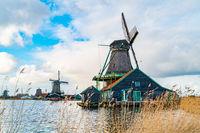 View of dutch windmills near the river Zaan in the Village of Zaanse Schans