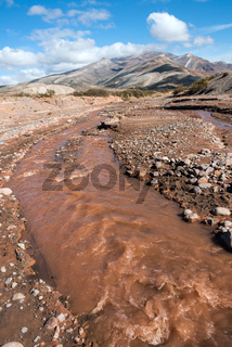 Layered sedimentary rocks in the colorful valley of the Rio Grande (Spanish for 'great river'), south of Mendoza Province, Argentina