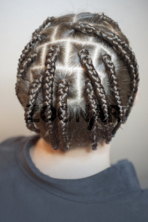 men's hairstyle from thin braids, creative waves of hair on the head of a man, head close-up, hair, creative shaving, Iroquois, top view