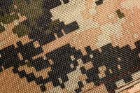 texture of old dirty camouflage pattern. close up