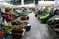 Market hall with local vegetables and fruits
