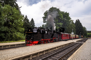 Old steam locomotive leaving the train station