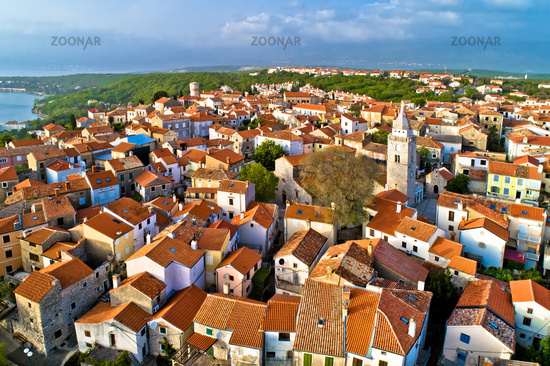 Town of Omisalj on Krk island old church and rooftops aerial view