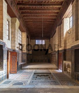 Hall at ottoman era historic house of Moustafa Gaafar Al Seleehdar, Cairo, Egypt with decorated ceiling and ornate marble floor