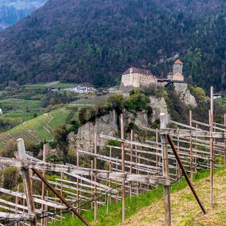 Tyrol Castle with landscape. Tirol Village, Province Bolzano, South Tyrol, Italy.