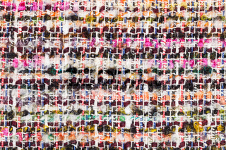 varicoloured woven yarns of boucle fabric close up