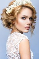 Make up. Glamour portrait of beautiful woman model with fresh makeup and romantic wavy hairstyle.