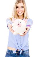 Beautiful woman holding  a piggy bank