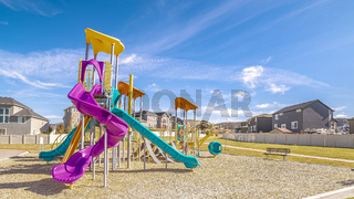 Panorama Brightly colored apparatus on a kids playground