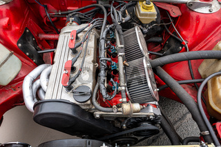 Engine of rally version of compact executive car Audi 80 GLE, close-up.