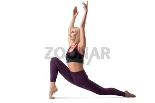 Slim blonde practicing yoga isolated view