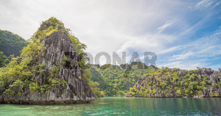 Twin Lagoon in Coron, Palawan, Philippines. Mountain and Sea. Lonely Boat. Tour A.