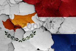 flags of Cyprus and Netherlands painted on cracked wall