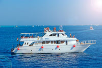 Cruise liner with tourists sailing on Red Sea. Sea voyage on white boat. Cruise ship with tourists o