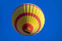 Yellow hot air baloon flying in sky