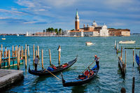 Gondolas and in lagoon of Venice by Saint Mark (San Marco) square