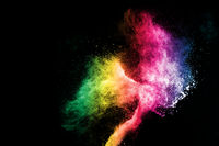 Abstract colorful powder explosion on black background.