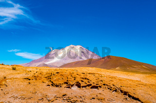 Natural landscape of active volcano Ollague at the Bolivia  - Chile border