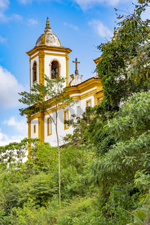 Ancient historical catholic church between vegetation in the city of Ouro Preto