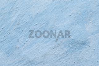 Aged adobe whitewashed wall, light-blue color, retor background, detailed texture