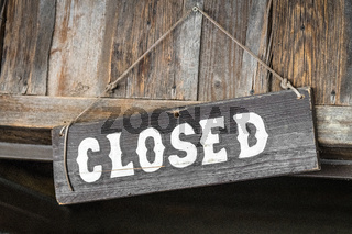 Closed for business sign made of wood