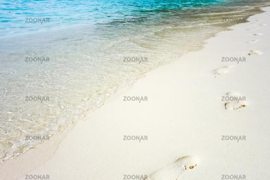 footprints on a tropical beach