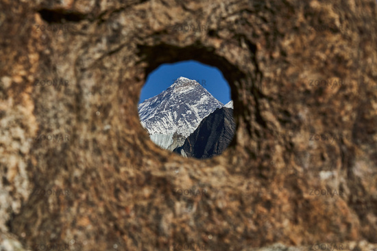 Peak of Mount Everest - seen thru a hole in a rock