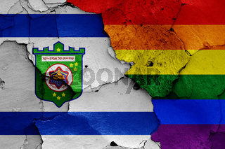 flags of Tel Aviv and LGBT painted on cracked wall