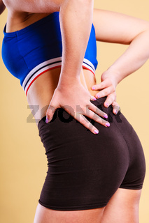 Fit woman suffering from back pain