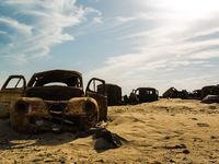 Dump cars in the desert. Rusting cars.