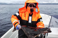 angler with caught halibut