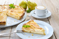 Pear tart with a cappuccino