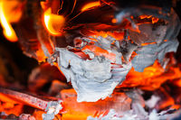 Paper burns in a stove
