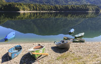 Rowing boats on the shore of the Sylvenstein reservoir, Bavaria, Germany
