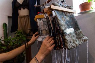 Young woman shopping for fashion bags