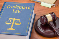 A law book with a gavel  - Trademark law