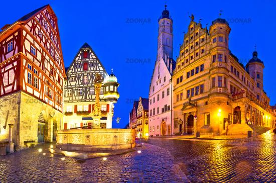 Main square (Marktplatz or Market square) of medieval German town of Rothenburg ob der Tauber evening panoramic view.