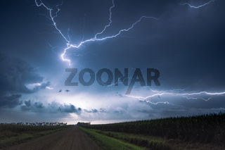 Lightning in the country over the field during a thunderstorm