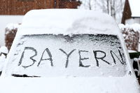 text on snowy windscreen