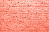 Coral pink toned brick wall background texture