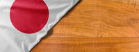 National flag of Japan on a wooden background with copy space